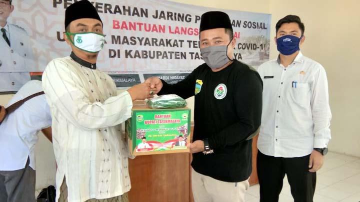 Koropak.co.id - Perkuat Ke RT Siaga, DMI Kabupaten Tasikmalaya Distribusikan Bantuan Alat Kebersihan